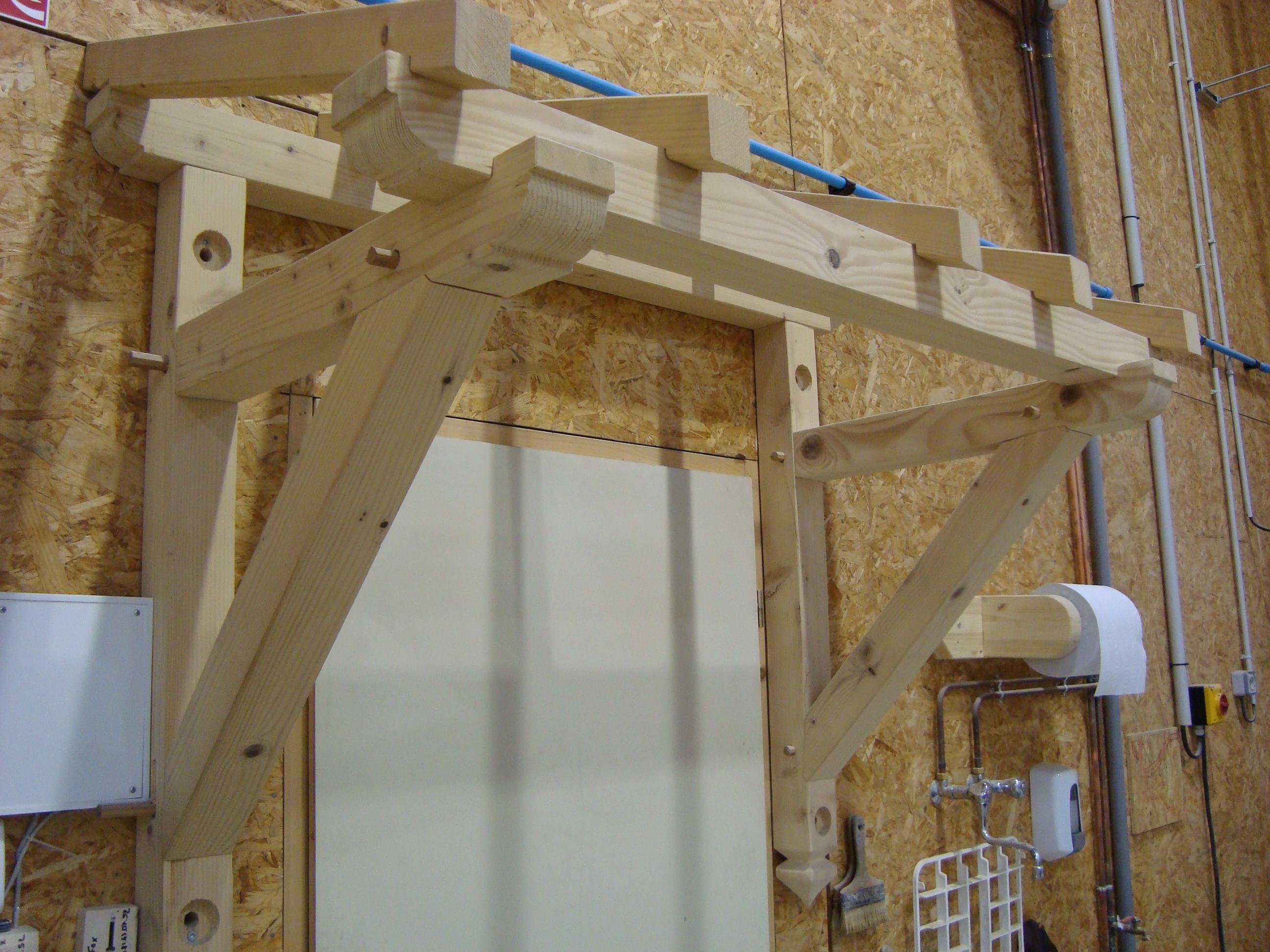 Marquise en bois menuiserie bertin - Fabriquer une porte sur mesure ...